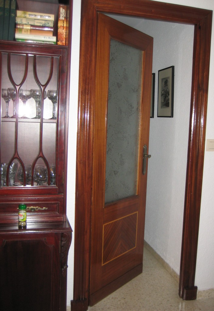 several interior doors like this - closing off the kitchen, entry way and hall way if needed.