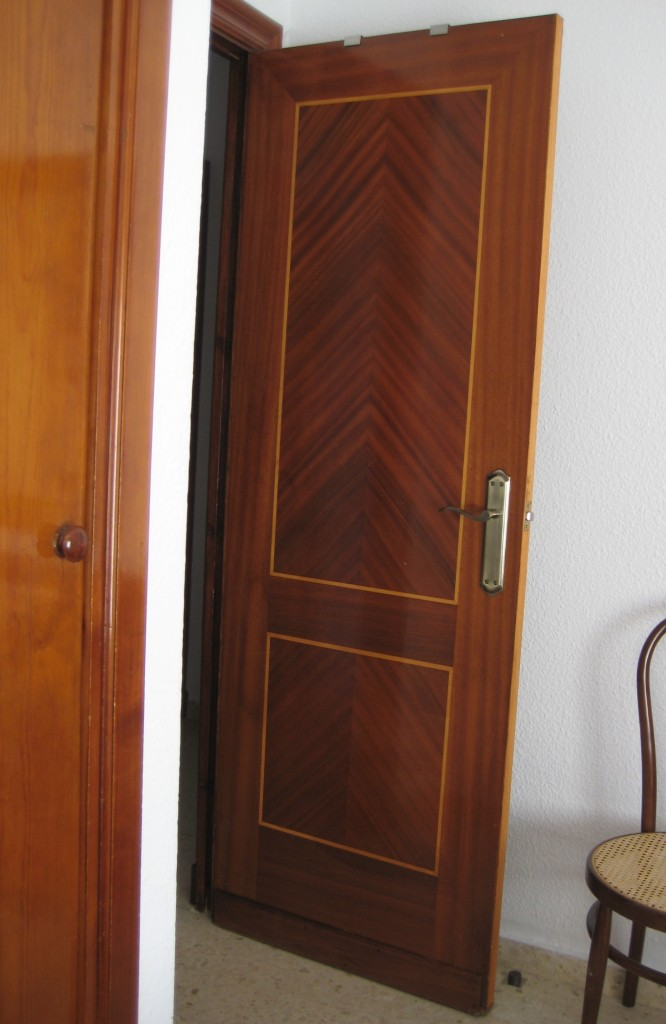 Nice interior doors.  Maybe from the 40's or 50's?